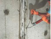 Ohio waterproofing contractor injecting urethane or polyurethane into a basement wall crack
