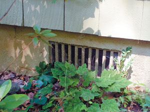 Grated Crawl Space Vents outside a home in Uhrichsville, OH