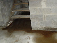 Water Pouring into a New Rumley Basement through Hatchway Doors