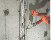 Manitoba waterproofing contractor injecting urethane or polyurethane into a basement wall crack