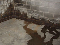 Water Flooding into a Oxford House basement through the Wall-Floor Joint