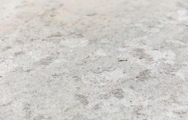 Freeze-Thaw Cycles Cause Pitting and Flaking of Concrete Surfaces