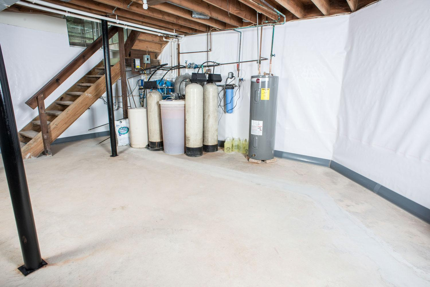 Dry basement with waterproofing system installed