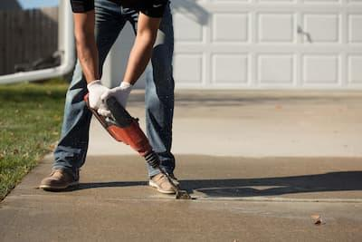 Concrete crack repair on a driveway