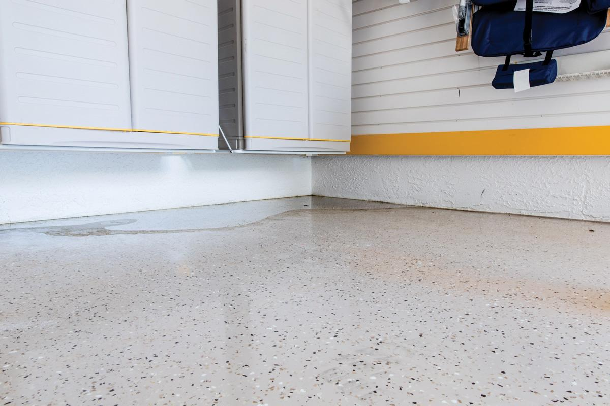 sloping garage floor water pooling