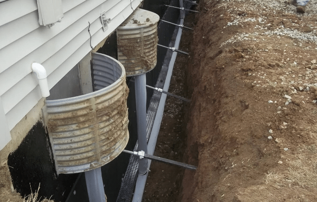 Bowed Walls in Kansas City, MO Repaired with Helical Tiebacks