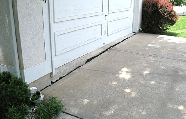 Settling Driveway, Garage Door Fixed with Master Mudjackers in Lenexa, KS