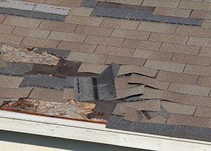roof damaged by wind storms