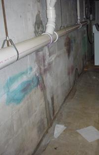efflorescence from damp basement walls