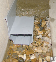 A no-clog basement french drain system installed in Bladenboro, North Carolina