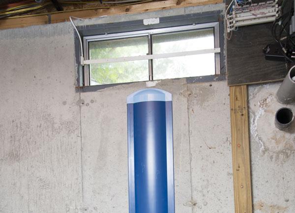 Repaired waterproofed basement window leak in Okotoks