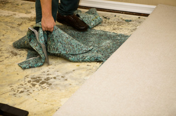 Removing wet carpet in Tampa home