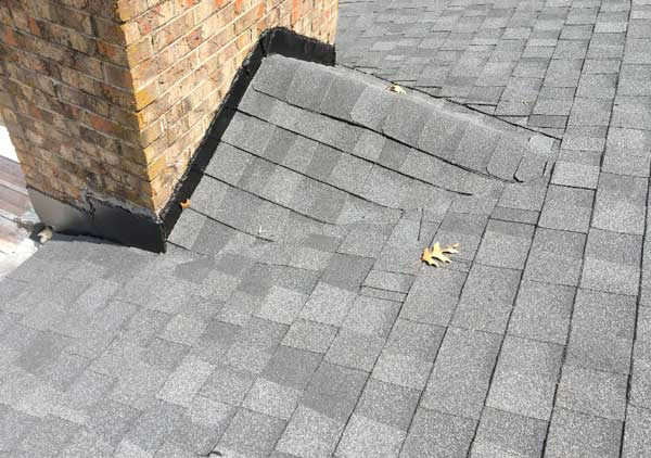 Cricket built on roof near chimney