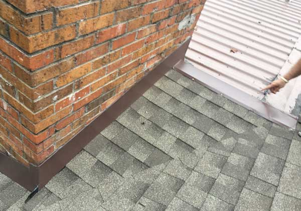 Roof cricket built between two areas of roof