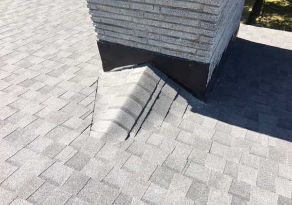 Roof cricket built to fit smaller chimney