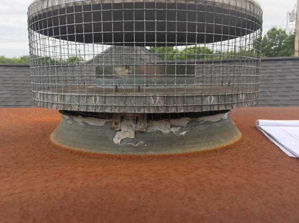 Rusted rain pan on chimney