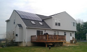 Summit Roofing & Siding installed a new roof around an existing solar installation.