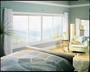 Bedroom with large gliding window