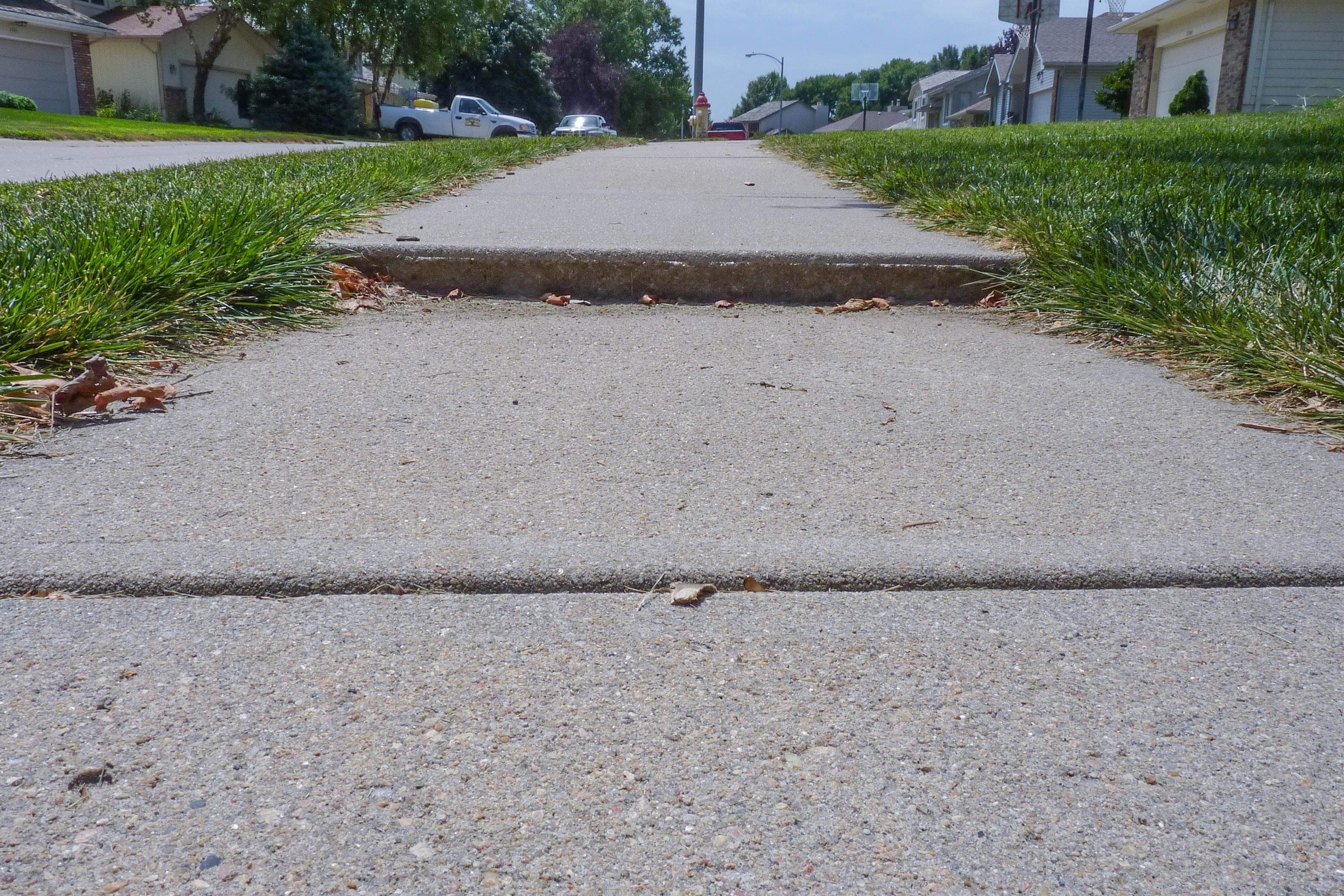 Sinking concrete walkway