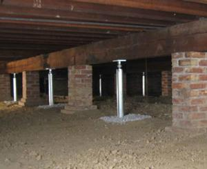 Crawl space support beams with jack posts installed in Kingston, TN
