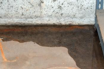 Water seepage where the basement wall meets the concrete floor
