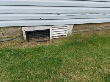 Exterior view of open crawl space vents