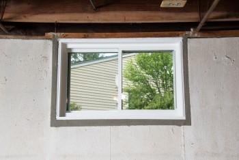 Interior view of a new EverLast vinyl basement window