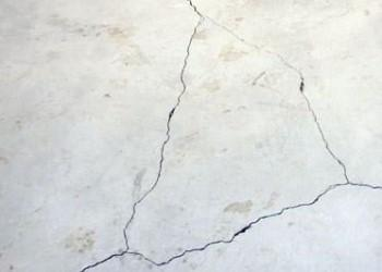 Foundation heave crack in a concrete basement floor