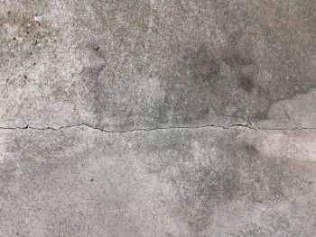 Hairline crack in a concrete basement floor