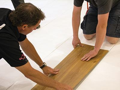 Installing MillCreek wood finish flooring on top of ThermalDry® insulated subflooring