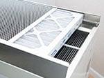 Closeup view of the air filter in a SaniDry XP dehumidifier
