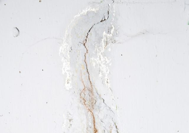 Stained crack in a basement wall