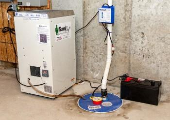 Sump pump and dehumidifier system installed a basement