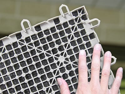 Closeup of the grid on the underside of a ThermalDry basement floor tile