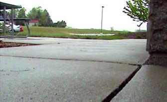Sunken sidewalk raised with PolyLevel®