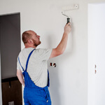 Professional Painter Painting A Wall White