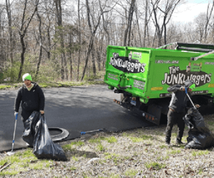 Junklugger employees picking up litter on side of road.