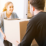 Two People Moving A Box Together