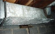 Condensation builds on ducts in the basement