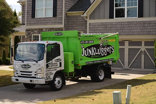 Junk lugger truck in driveway
