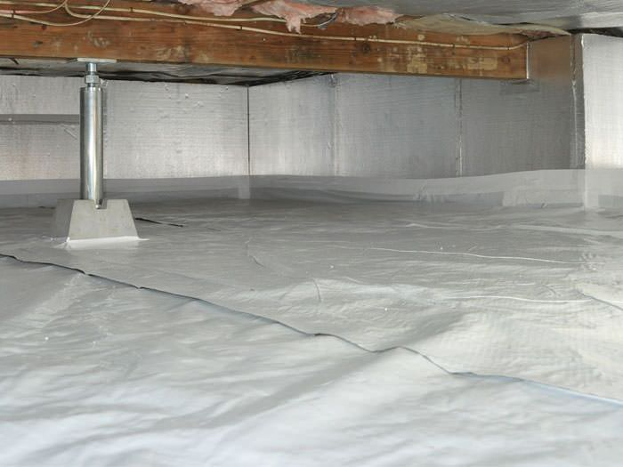 Crawl space with vapor barrier installed in Fredericton, NB