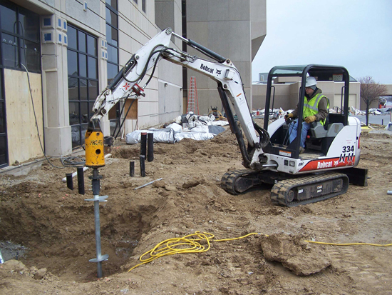 Commercial push pier system installation in Charlottetown, PE
