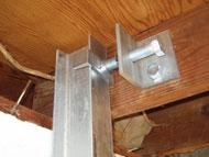 steel wall beam fastened to floor joist