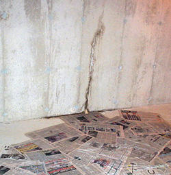 Water leaking from a crack in a foundation wall in Concord, North Carolina