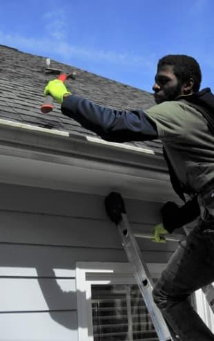Gutter Shutter Contractor Installing Our Gutter Guard System