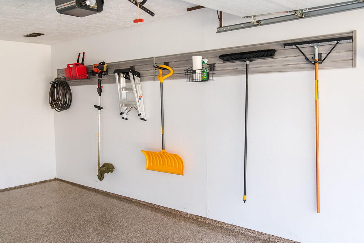 This organized garage uses slatwall to hang tools and other equipment.