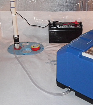 Closeup of a crawl space sump pump installed in Essex