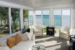 Enjoy the outdoors from inside your new sunroom in Harborcreek