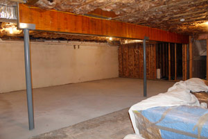 BEFORE: When finishing any size basement, be sure to think about how you will store the stuff you will still need to store.