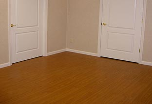 Real wood is not recommended for basement flooring. If you want the look and feel of wood, vinyl plank is the preferred choice.